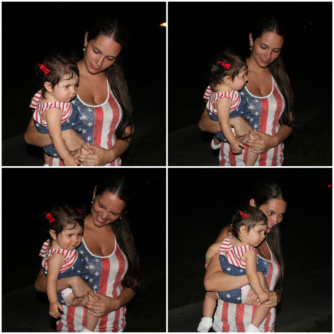 She was watching the fireworks on the floor and also squinting because of the flash.. Poor baby, so many lights everywhere!